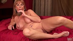 Fabulous mature lady Rae Hart have fun with electrical fuck stick in bedroom