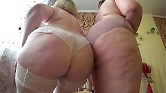 Sexual make-out of 2 mature lesbians with thick asses, gradual undressing and caress.