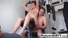 Pierced granny gets an ass fucking workout in the gym